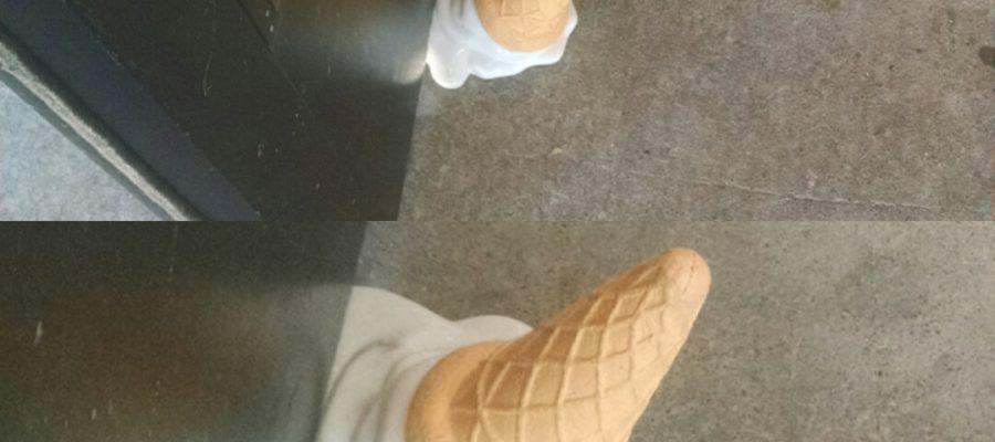 A ice-cream store uses a ice-cream cone door stopper